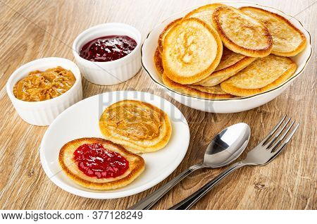 Bowls With Raspberry Jam And Peanut Butter, Bowl With Heap Of Pancakes, Pancakes With Jam And Peanut
