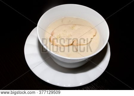 Creamy Mushroom Soup In The White Bowl . Side View