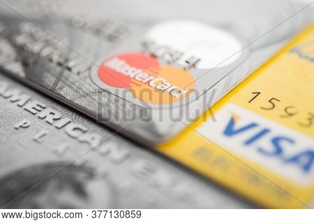 Vilnius, Lithuania -July 05 2020: Closeup studio shot of credit and debit cards issued by American Express, VISA and MasterCard