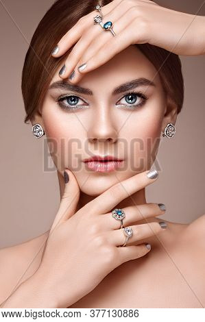 Fashion Portrait Of Young Beautiful Woman With Jewelry. Brunette Girl. Perfect Make-up.  Beauty Styl
