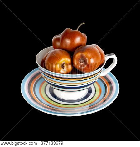Apples Of Paradise Are Beautifully Stacked In A Multi-colored Cup On A Saucer. Multi-colored Stripes
