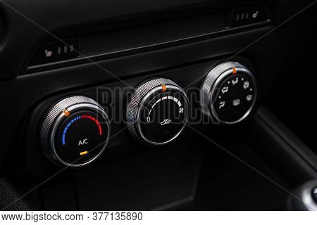 Close Up Instrument Automobile Panel With  Climat Control View With Air Conditioning Buttons- Detail