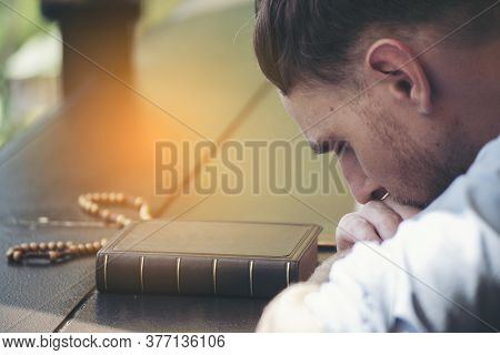 Prayer And Bible Concept. Caucasian Man Praying, Hope For Peace The World And Free From Coronavirus,
