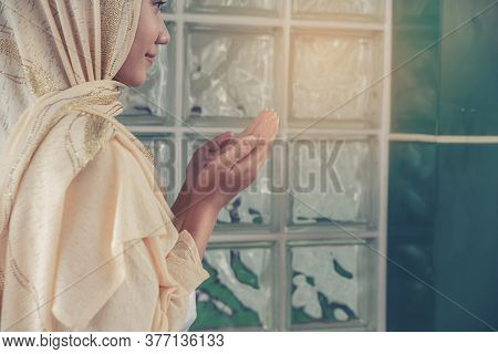 Prayer And Bible Concept. Muslin Woman Praying, Hope For Peace And Free From Coronavirus, Hand In Ha