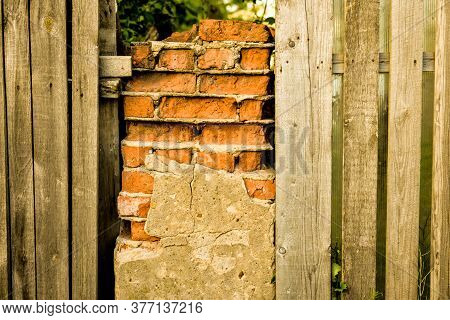 Old Ruined Brickwork And A Surface Of Vintage Wooden Boards