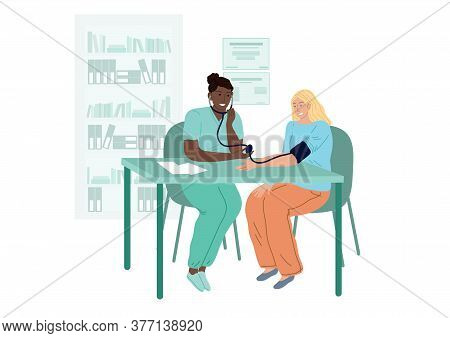 Doctor Measures The Patients Blood Pressure. A Woman At A Cardiologists Appointment.
