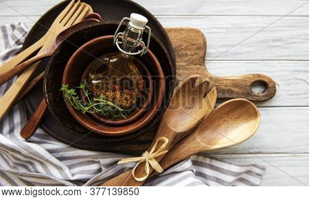 Top View On A Wooden Cutlery Kitchen  Ware On A  Wooden Background, Flat Lay