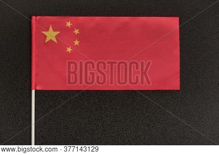 Table Flag Of China On Black Background. National Symbol Of Peoples Republic Of China.