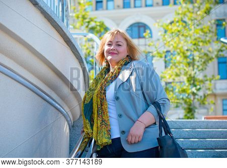 Happy Overweight Woman Walking The City Street At Good Day. Sunny Portrait Of Size Plus Lady. Beauti