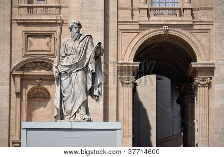 The statue of Saint Paul in St. Peter's Square in Vatican City, Rome, Italy. The statue was sculpted in 1838 by Adamo Tadolini. poster