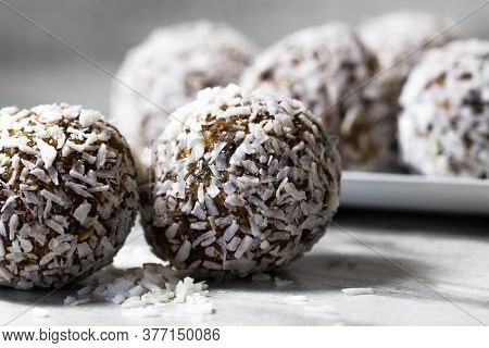 Homemade Energy Balls With Dried Apricots, Raisins, Dates, Prunes, Walnuts And Coconut. Healthy Swee
