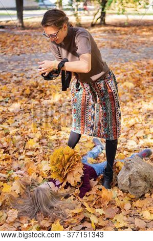 Backstage. Backstage. Photographer At Work Makes Autumn Portrait Of A Model - Little Girl