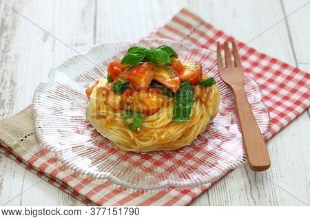 summertime chilled style, capellini pasta with fresh tomatoes and basil