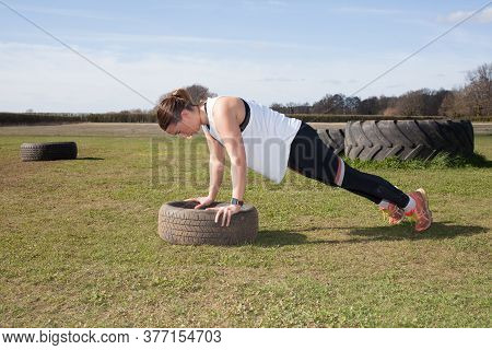 A Woman Exercising On A Farm In The Uk Doing Push Ups, Taken 16th March 2020 In Abingdon, Oxfordshir