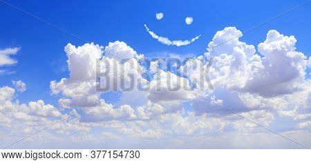 Happy concept. Smilie from white cloud in the blue sky