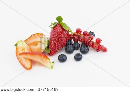An Assortment Of Strawberry Slices, A Strawberry, Blackberries And Red Currant. Vegan Food Concept.