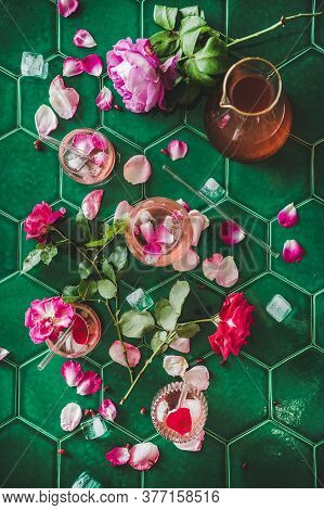 Rose Lemonade With Ice And Rose Petals Over Green Table