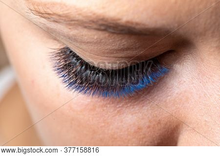 Blue Eyelash Extension with diferent colors. Lashes. Woman Eyes with Long Eyelashes in diferent color.