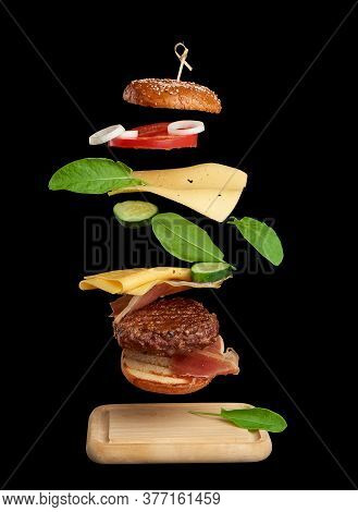 Levitating Cheeseburger Ingredients: Juicy Meat Cutlet, Cheddar Cheese, Sesame Bun, Lettuce, White O