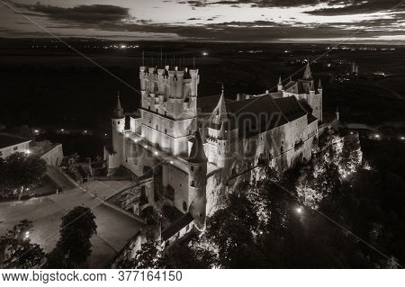 Alcazar of Segovia as the famous landmark aerial view at night in Spain.
