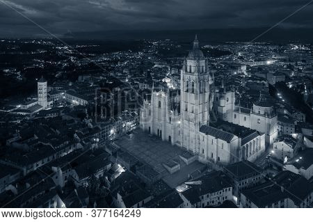 Segovia Cathedral aerial view at night in Spain.