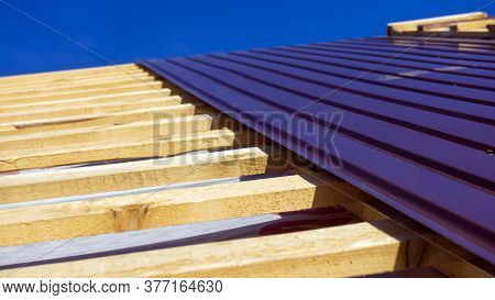 An Flat Roof With Roofing And Fencing