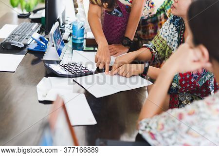 Group Of Tourist Woman Discuss Details Of Payment Receipt At Hotel Reception.