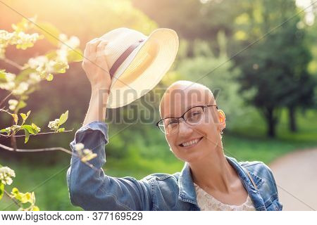 Happy Young Caucasian Bald Confident Hipster Woman Take Off Hat And Enjoying Life After Surviving Br