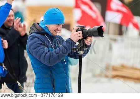 Verkhoshizhemye, Russia - 03.07.2020 - Cameraman Takes Holiday Video. Happy Smiling Man With Camera