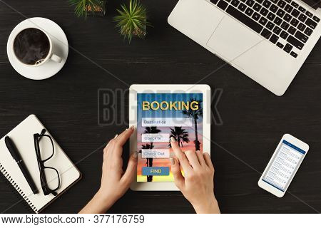 Businesswoman Using Tablet Booking Hotel Accommodation Online Planning Business Trip At Workplace In
