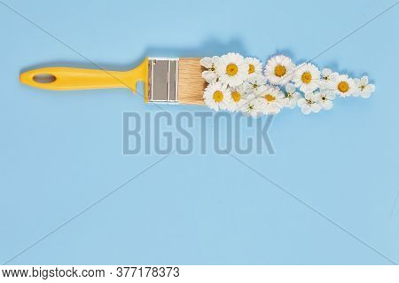 Creative Spring Blossom Concept. Paint Brush With Flower On A Blue Pastel Background. Spring Time. S