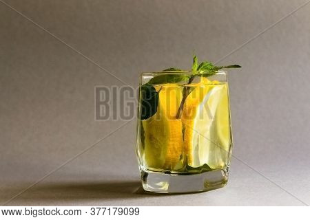 Summer Healthy Lemonade, Cocktails Of Citrus Infused Water Or Mojitos, With Lime Lemon Orange, Ice A