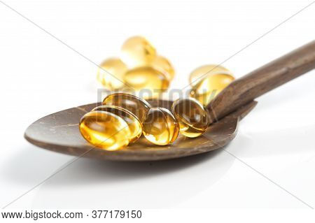 Yellow Pills Vitamin E Soft Gels / Food Supplement On White Background