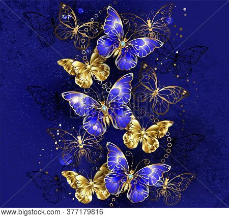 Composition Of Luxurious Sapphire And Gold Jewelry Butterflies On Blue Textured Background.