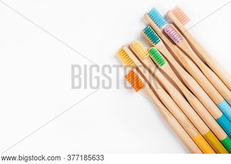 Flatlay With Colorful Wooden Bamboo Toothbrushes Isolated On White Background. Zero Waste Concept.