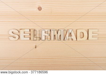Colorful And Crisp Image Of Term From Wooden Letters On Pale Wood