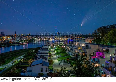 Comet C 2020 F3 Neowise In Night Sky Over Phoenix Lake In Dortmund, Germany. City Skyline And Floria