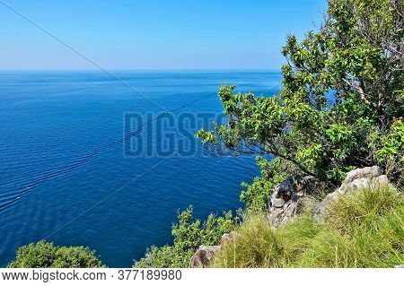 Bright Turquoise Andaman Sea And Clear Azure Sky. On Calm Water Ripples From A Standing Wave. In The