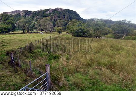 A Pastoral Landscape In The Foothills Of The Snowdonia National Park In North Wales.  Green Fields A