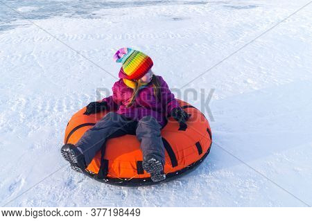 Young Smiling Girl Ride Sleigh Snow Tubing