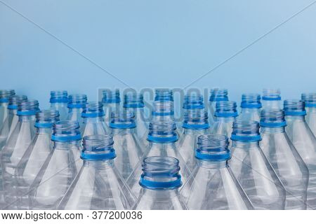 Horizontal Color Image With A Front View Of An Empty Clear Plastic Bottles Without Caps Stacked On A