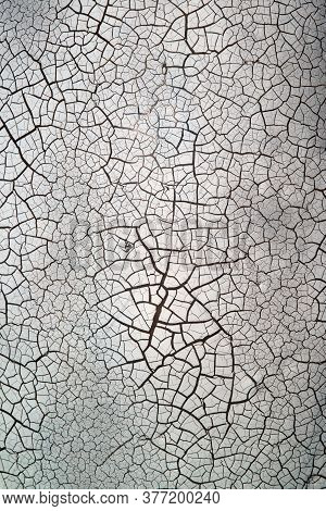 The Surface Is Close To Colour And Cracks In White Background.