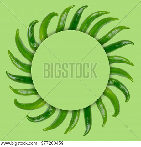 Creative Layout Of Green Pepper Pods With A Note Card. Flat Lay. Nature Concept.