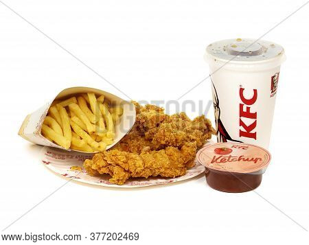 Bucharest, Romania - October 5, 2015. Kfc Crispy Strips Menu With French Fries, Soda Cup And Ketchup