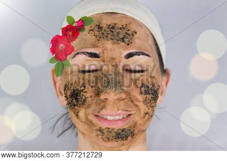 Beauty Day. Close-up Of A Woman`s Face. The Woman Has A Clay Face Mask And Eyebrows Painted Black. T