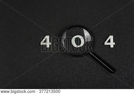 Numerals 404 And Magnifying Glass On Black Background. Error Concept.