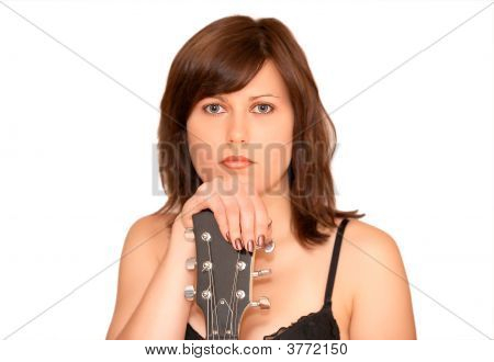 Young Beautiful Woman With Guitar In Hands