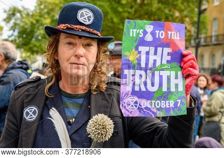London - October 18, 2019: Close Up Of Eccentric Extinction Rebellion Protester Holding A Protest Si