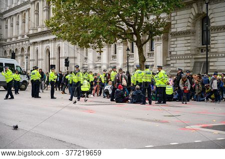 London - October 18, 2019: Metropolitan Police Officers Gather Ready To Move Extinction Rebellion Pr