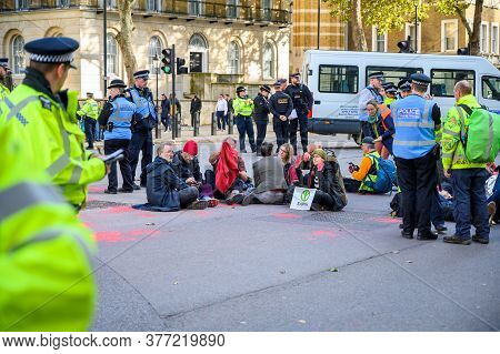 London - October 18, 2019: Extinction Rebellion Protesters In Whitehall At A Sit In